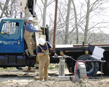 Men drilling a well