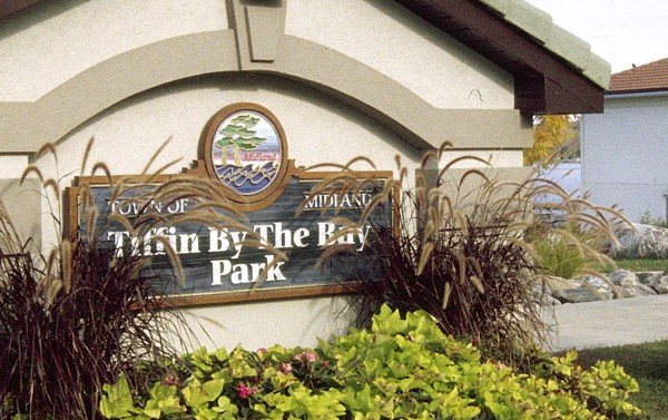 Tiffan By The Bay Sign